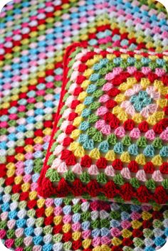 Granny Square pillow and blanket... lovely!