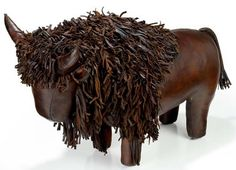 "Buffalo Handcrafted Leather Footstool. After mastering the art of making pigs, Dimitri Omersa embarked on expanding the range of animals. He started by introducing the very popular rhinocerous, elephant and donkey. He struck up an ""exclusivity"" deal with Liberty's of Regent Street, London in the early 1960's to sell these items. This arrangement expired during the mid 1970's. Animals from this period can be found with the word ""LIBERTY"" embossed on the undersid..."