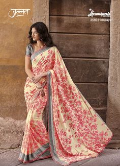 Gorgeous Peach Coloured Georgette saree with its relishing Floral Print which will add more charm to your Feminity and will make you look charming like never before. It will be carrying Dark Slate Grey Satin Blouse. www.laxmipati.com