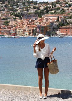 Floppy hat, flats, and a flowy white blouse make this outfit very vacation-ready!