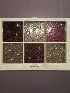 Old window with marbles in epoxy resin.