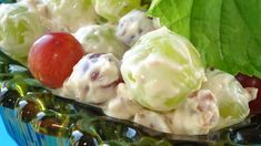 Green grapes are folded into a sweetened cream cheese and sour cream mixture freckled with pecan bits in this fruit salad.