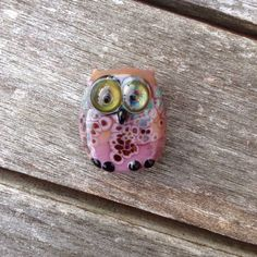 A personal favorite from my Etsy shop https://www.etsy.com/listing/251008631/lampwork-owl-bead