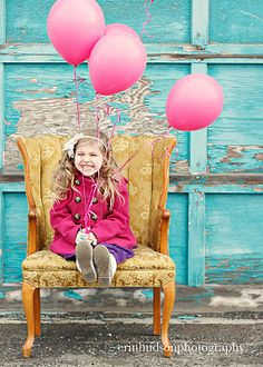 Happiness is a 4year  old with balloons,, even though is it 24 degrees out.