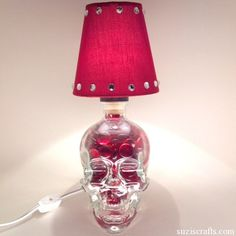 crystal skull lamp - DIY bottle lamps.  I want to do this one for halloween!  It would be awesome!