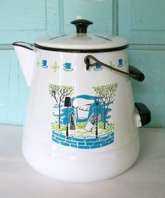 Vintage Enamel Coffee Pot or Drink Pitcher with Barbeque Theme Mid Century Modern Design Large Beverage Container, white with turquoise, green, and black. No maker marks on it so not sure its history. Its in excellent condtion no chips or damage. This will hold about a gallon and a half of liquid its 9 tall, 6 1/4 diameter on the top, 8 1/2 on the bottom. This is functional and a great home decor piece too