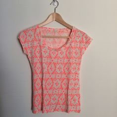 J.Crew coral/neon pink print tee Very cute and comfortable, great for spring and summer. 100% cotton. In great gently used condition. J. Crew Tops