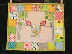 Super cute mini quilt. I think I might have to try this with bigger pieces. Those small pieces are just crazy.