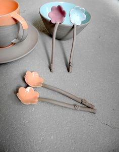 Grey with orange, mint & lilac.  Like these spoons