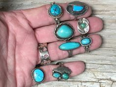 Southwestern turquoise ring in sterling silver. Navajo-style. No hallmarks. Acid tested sterling silver. Hand wrought. Stamp decorated raindrop. Size: 8, hand hewn shank with cold chisel split and fil