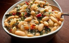 This easy recipe for braised white beans with chard has canned cannellini beans, onion, garlic, Swiss chard, and parsley.