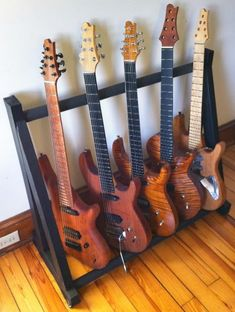 DIY: $25 Multi-guitar stand. Need this!! Boyfriend has a lot of guitars ... this would really come in handy!