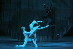Svetlana Zakharova and David Hallberg (with Vladislav Lantratov) in <I>Swan Lake</I>.<br />© Damir Yusupov. (Click image for larger version)