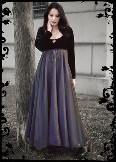 full circle skirt of bias-cut chiffon layered over satin, with a simple stretch velvet bodice with empire waistline trimmed in cording and ribbon. Not to hard to make...