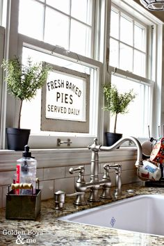 Graff bridge faucet with Rohl's Shaw Farm sink in DIY kitchen-www.goldenboysandme.com