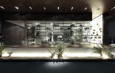 the great wall in transparent glass characterizes an outer side of the stand