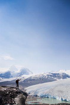 ✭ A man admires a blue glacier fed lake on a sunny summer day - Bella Coola, British Columbia - Canada