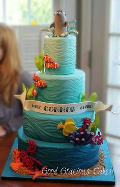This was an ocean themed cake that I made for Icing Smiles recipient 6 year old Connor. Connor was celebrating one year of being cancer free. This was also Icing Smiles cake Ocean Cakes, Beach Cakes, Fondant Cakes, Cupcake Cakes, Decors Pate A Sucre, Dolphin Cakes, Nemo Cake, Nautical Cake, Mermaid Cakes