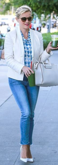 Reese Witherspoon: Shirt – Red Valentino  Purse – The Row  Jeans – Mother  Shoes – Christian Louboutin