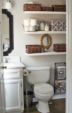 Small bath?  Neat way to utilize space... wide shelving.