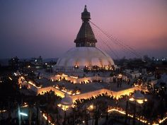 Boudhanath Temple in Nepal .. Buddhist monks arrange oil lamps in the pattern of a mandala .. incredible