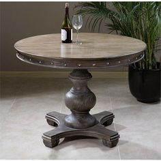 The Uttermost Sylvana Wood round Accent Table is a robust design from artist Caroly Kinder that features a beautifully carved base and an expansive,. Round Wood Dining Table, Round Accent Table, Pine Table, Dining Table In Kitchen, A Table, Dining Tables, Painted Round Tables, Tuscan Kitchen Decor, Round Kitchen