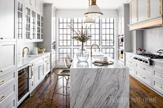 Brass tones bring modern flair to a classic—and compact—kitchen inside a Baltimore rowhouse