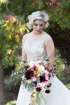 Lush garden boho inspired bridal bouquet   burgundy dahlia and garden roses