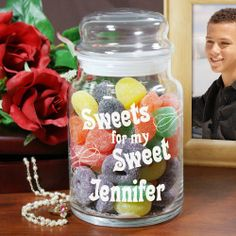"""Personalized Sweets for My Sweet Glass Treat Goodies Jars. Fill the heart of your sweet with sweet candies from the heart with our Personalized Valentines Day Candy Jar. A lovely, personalized goodies jar perfect for filling with his or her favorite sweet candies. Your Personalized Treat Jar makes for a thoughtful and personal Valentine Gift. Your Engraved Sweet Treat Glass Jar measures 5.5""""H x 4""""W and holds 26 oz. Each glass jar comes with an air-tight glass lid."""