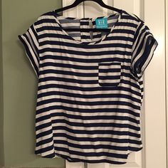 """Escapada Kendall Top Navy Blue and White. Excellent used condition worn twice. Shortened in length approximately 2"""", stock photos for reference only as the colors are different. Escapada Tops"""