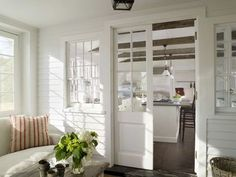 Sliding pocket door with glass panels in an enclosed porch.