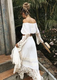 white off the shoulder maxi dress with lace hem.