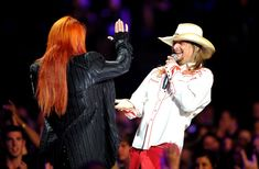 Kid Rock Photos Photos - Singer Wynonna Judd and musician Kid Rock perform on stage at the 2011 CMT Music Awards at the Bridgestone Arena on June 8, 2011 in Nashville, Tennessee. - 2011 CMT Music Awards - Show