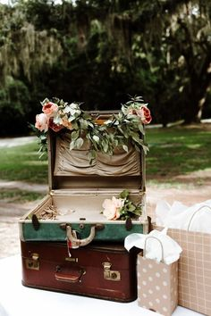 Wedding Reception Food Ask guests to place their presents in vintage suitcases for a retro- or travel-inspired wedding. These ones were decorated with Edward on Saint Simons flowers. - Accept presents graciously with one of these styling ideas. Gift Table Wedding, Card Box Wedding, Wedding Seating, Wedding Reception Decorations, Rustic Wedding, Wedding Favors, Retro Wedding Decor, Fall Wedding, Reception Food