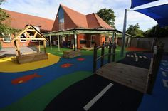 Fun and exciting playground design with colourful wetpour surfacing, for Merton Park primary school in Wimbledon.