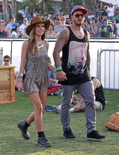 See All the Celebrities at Coachella This Year: Kirsten Dunst and Garrett Hedlund held hands on their way into the Neon Carnival.  : Alessandra Ambrosio walked around with her fiancé, Jamie Mazur. : Kate Bosworth wore white lace to hang with fiancé Michael Polish. : Audrina Patridge and Corey Bohan held hands.