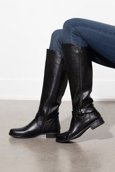 A simple tall black boot is an absolute essential in every woman's wardrobe! These beautiful boots feature a side zipper closure, a rounded toe and a small rubber heel. We know you'll be walking with confidence as soon as you slip these on! Silver Icing, Online Collections, Fashion Company, Every Woman, Black Boots, Riding Boots, Fashion Online, Confidence, Walking