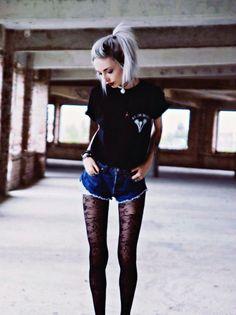 Black shirt, dark blue ripped shorts and black Laced tights