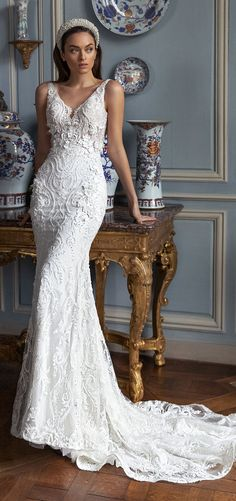 Lace mermaid wedding dress with deep v-neckline and thick strap for the romantic bride. Pollardi Wedding Dresses 2021 Royalty Collection - Belle The Magazine #weddingdress #weddingdresses #bridalgown #bridal #bridalgowns #weddinggown #bridetobe #weddings #bride #dreamdress #bridalcollection #bridaldress #dress See more gorgeous bridal gowns by clicking on the photo