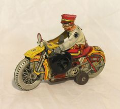 Tin windup Motorcycle and Cop is in good working condtion. This is a great tin toy of a police on a motorcycle. When it is wound the tires turns, motorcycle turns and speeds off towards the left. Measures 8 1/4 long x 5 3/4 tall. | eBay!