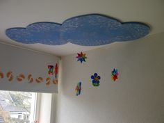 Cloud from MDF, painted bleu and sponge with blue, grey and with some effect on it. Make from Ironing Beads, stars, flowers and a butterfly and you have a nice cloud for a kids room