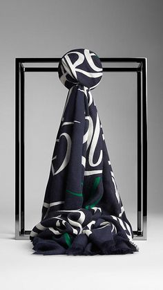 Burberry ink print Typographic Print Cashmere Scarf - A cashmere scarf featuring a typographic print.  Inspired by vintage book covers, the artwork is painted by hand before being printed onto lightweight cashmere.  Discover the scarf collection at Burberry.com