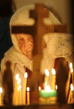A woman at an Orthodox Christmas service at Vladimir Ravnoapostolny Cathedral in Sochi, Russia.