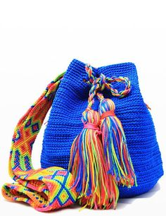 """Woven Mayan mochila bag, perfect for the beach or a night out. This is a product that fits perfectly with our """"slow fashion"""" philosophy! So many colors to choose from, how shall we pick? :D"""