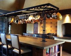 island with iron pot rack. Home built by JMA (Jim Murphy and Associates); designed by Taylor Lombardo Architects. Photo credit: Chris Larrance.