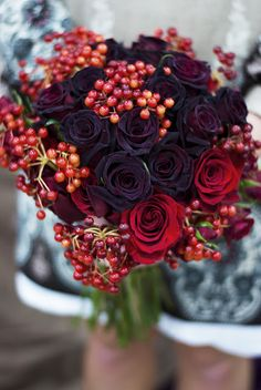 Mix of Black Baccara (the darker ones) and Black Magic Roses (more crimson red).