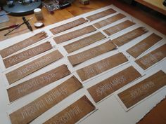 Making nametags for participants. White gouache on dyed papyrus. Georgia Angelopoulos