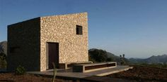 """Residential Architecture: La Vall de Laguar House by Enproyecto Arquitectura: """"..The simple house, situated in a village perched on a mountain overlooking the Mediterranean Sea, is located on a site not easily accessible, full of cherries and open views..The planning regulations only allowed a small building to store agricultural tools not exceeding 25 m2 and a buried cistern to water of 50 m2 . The main space of this construction becomes in this case in a living room and kitchen, and upon…"""
