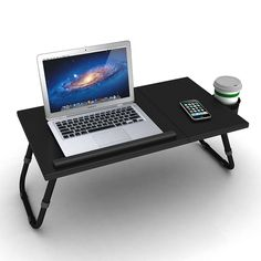 Enjoy surfing the web efficiently from the comfort of your bed with this Adjustable Laptop Tray. Height adjustable legs and 4 tilting positions allow you to work at just the right angle. Plus, a side-mounted cup holder helps keep your electronics safe. Laptop Tray, Laptop Table, Laptop Stand For Bed, Black Coffee In Bed, Bed Risers, Bed Tray, Tv Trays, Portable Table, Dorm Bedding