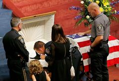 August 22, 2014 - Sgt. Ryan Stark says goodbye to his K-9 partner, Kye, at Kye's funeral in Oklahoma City. Kyae ws killed in the line of duty early that week.